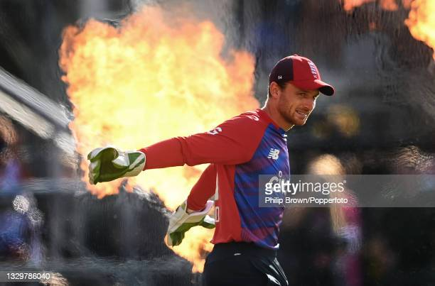 Jos Buttler of England walks on to the field past pyrotechnics before the 3rd Vitality T20 International between England and Pakistan at Emirates Old...