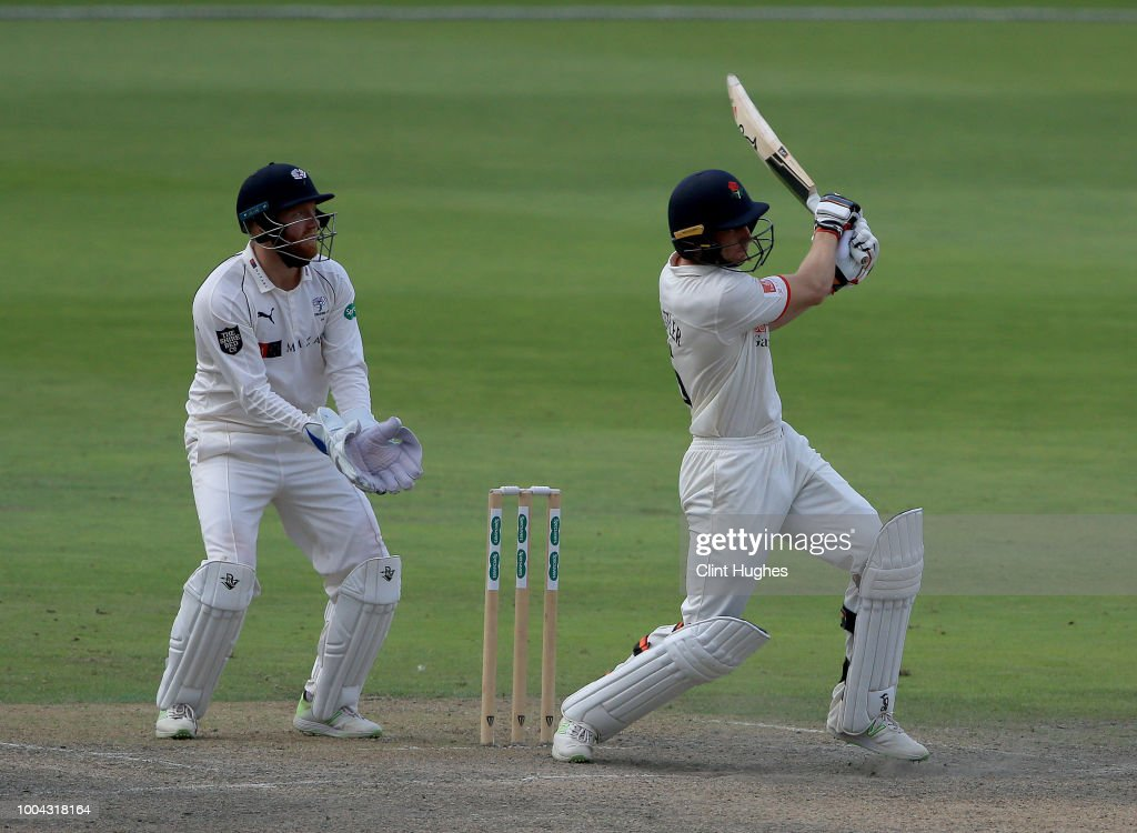Jos Buttler (R) of Lancashire bats during day two of the Specsavers County Championship division one match between Lancashire and Yorkshire at Emirates Old Trafford on July 23, 2018 in Manchester, England.