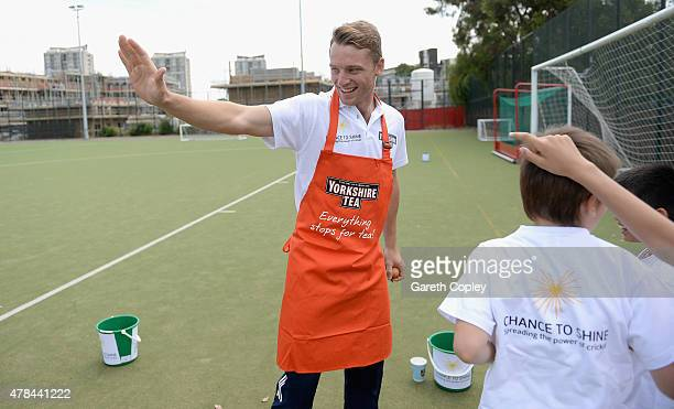 Jos Buttler of Lancashire celebrates with school children after beating Michael Vaughan of Yorkshire in Roses clash during an event to celebrate...