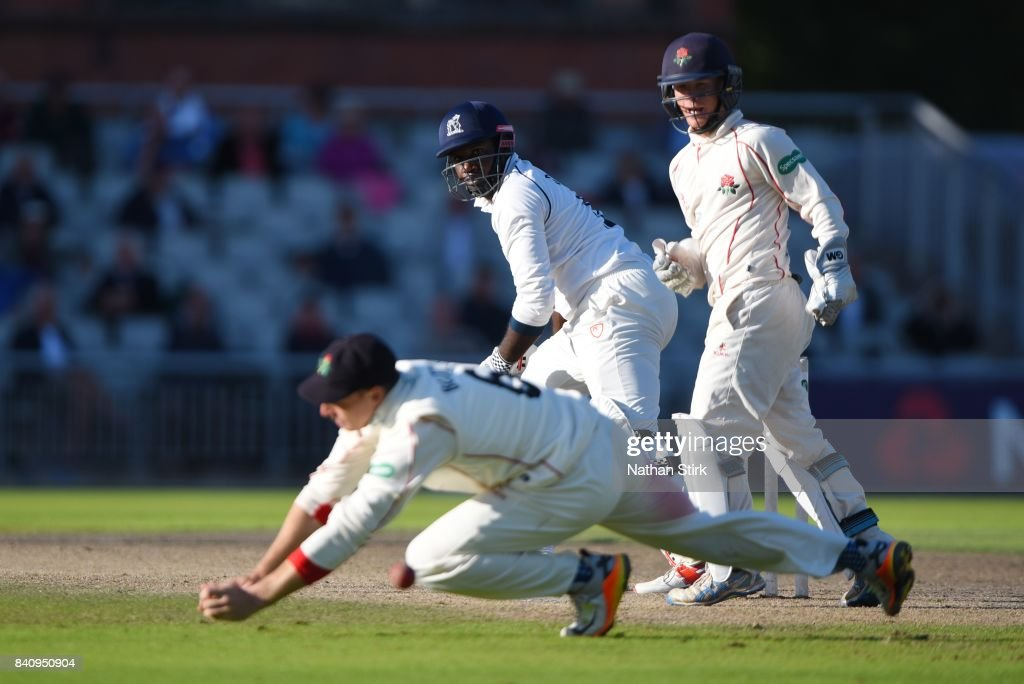 Jos Buttler of Lancashire drops Keith Barker of Warwickshire during the County Championship Division One match between Lancashire and Warwickshire at Old Trafford on August 30, 2017 in Manchester, England.