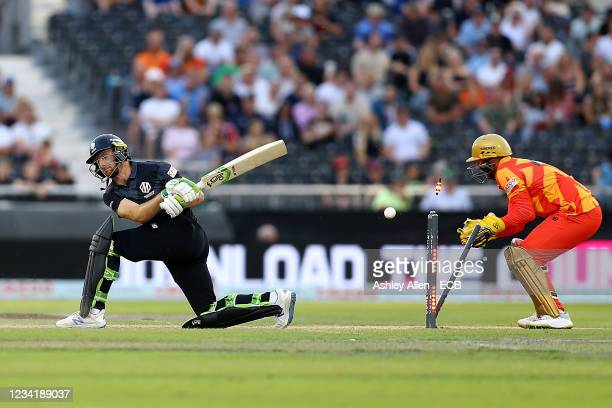 Jos Buttler of Manchester Originals is bowled by Liam Livingstone of Birmingham Phoenix during The Hundred match between Manchester Originals Men and...