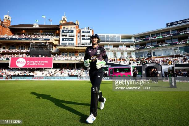 Jos Buttler of the Manchester Originals walks on to the field during The Hundred match between Oval Invincibles Men and Manchester Originals Men at...