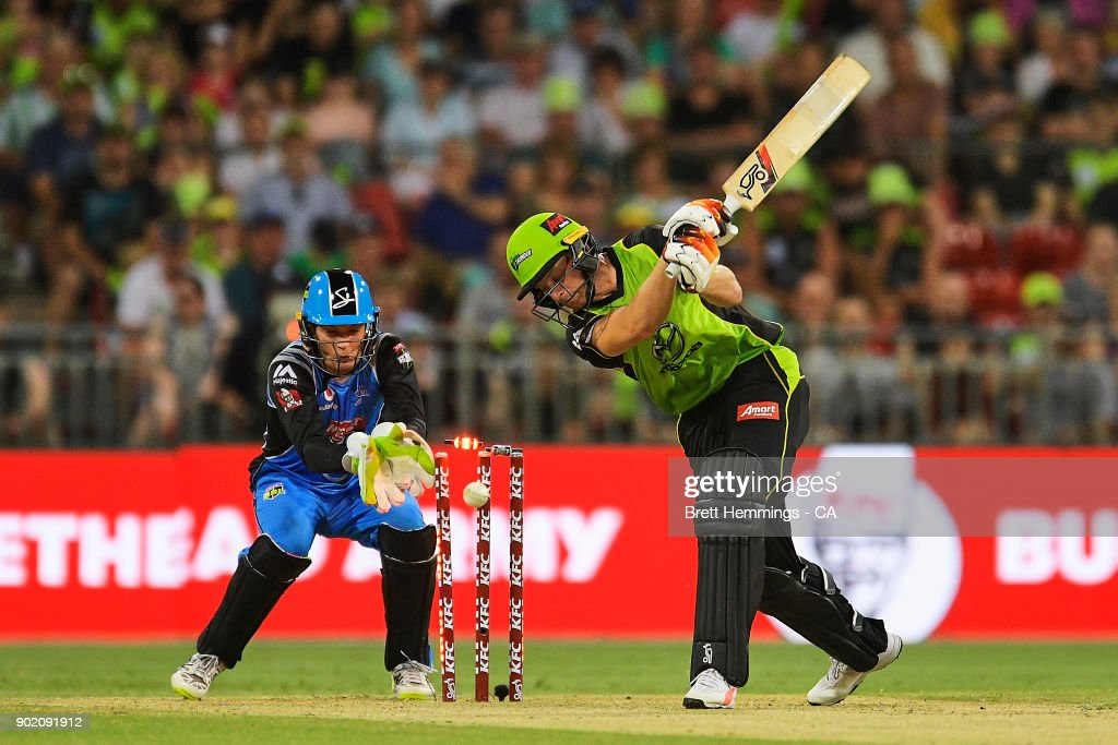 Jos Buttler of the Thunder is bowled out by Rashid Khan of the Strikers during the Big Bash League match between the Sydney Thunder and the Adelaide Strikers at Spotless Stadium on January 7, 2018 in Sydney, Australia.