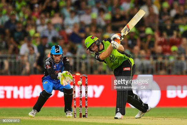 Jos Buttler of the Thunder is bowled out by Rashid Khan of the Strikers during the Big Bash League match between the Sydney Thunder and the Adelaide...
