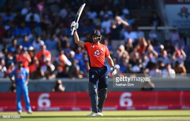 Jos Buttler raises his bat after scoring 50 runs during the 1st Vitality International T20 match between England and India at Emirates Old Trafford...