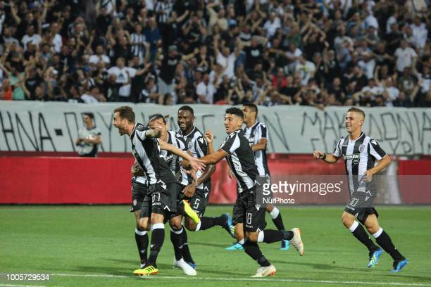 José Cañas of PAOK celebrates with teammates the first goal during Champions League second qualifying round first leg football match between PAOK FC...