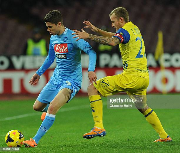 Josè Callejon of Napoli and Luca Rigoni of Chievo in action during the Serie A match between SSC Napoli and AC Chievo Verona at Stadio San Paolo on...