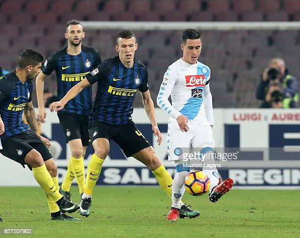 Josè Callejon of Napoli competes for the ball with Ivan Perisic of Inter during the Serie A match between SSC Napoli and FC Internazionale at Stadio...