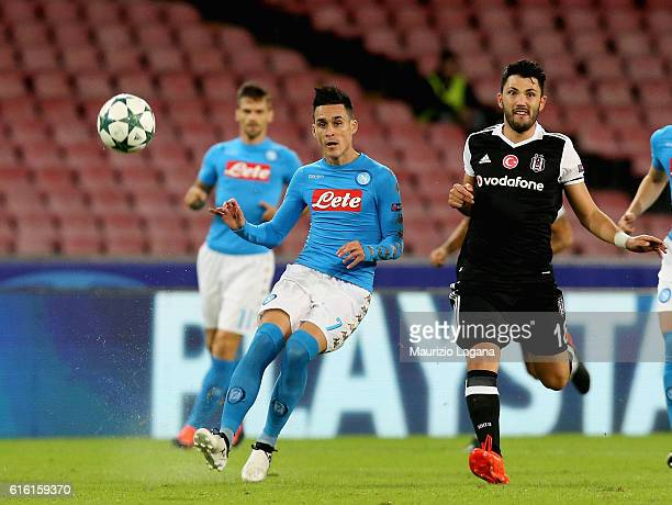 Josè Callejon of Napoli competes for the ball with Tolgay Arslan of Besiktas during the UEFA Champions League match between SSC Napoli and Besiktas...