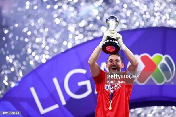 José de Jesús Corona goalkeeper of Cruz Azul lifts the champion's trophy at the end the Final second leg match between Cruz Azul and Santos Laguna as...