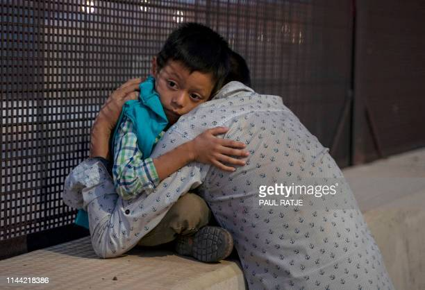 José embraces his son, José Daniel after crossing the border into the US, May 16 in El Paso, Texas. Both spent a month trekking across Mexico from...