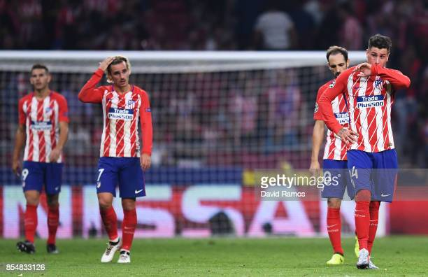 José Gimenez of Atletico Madrid and team mates look dejected after Chelsea score their second goal during the UEFA Champions League group C match...