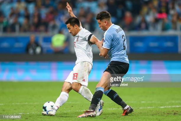 José Giménez of Uruguay battles for the ball against Shinji Okazaki of Japan during the Copa America Brazil 2019 group C match between Uruguay and...