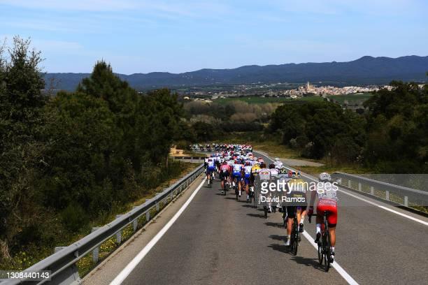 José Herrada Lopez of Spain and Team Cofidis, Chris Harper of Australia and Team Jumbo - Visma & the peloton during the 100th Volta Ciclista a...