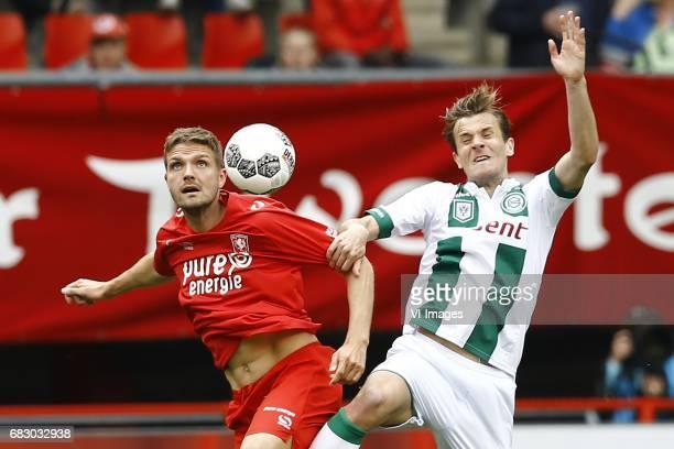 Jos Hooiveld of FC Twente Etienne Reijnen of FC Groningenduring the Dutch Eredivisie match between FC Twente and FC Groningen at the Grolsch Veste on...