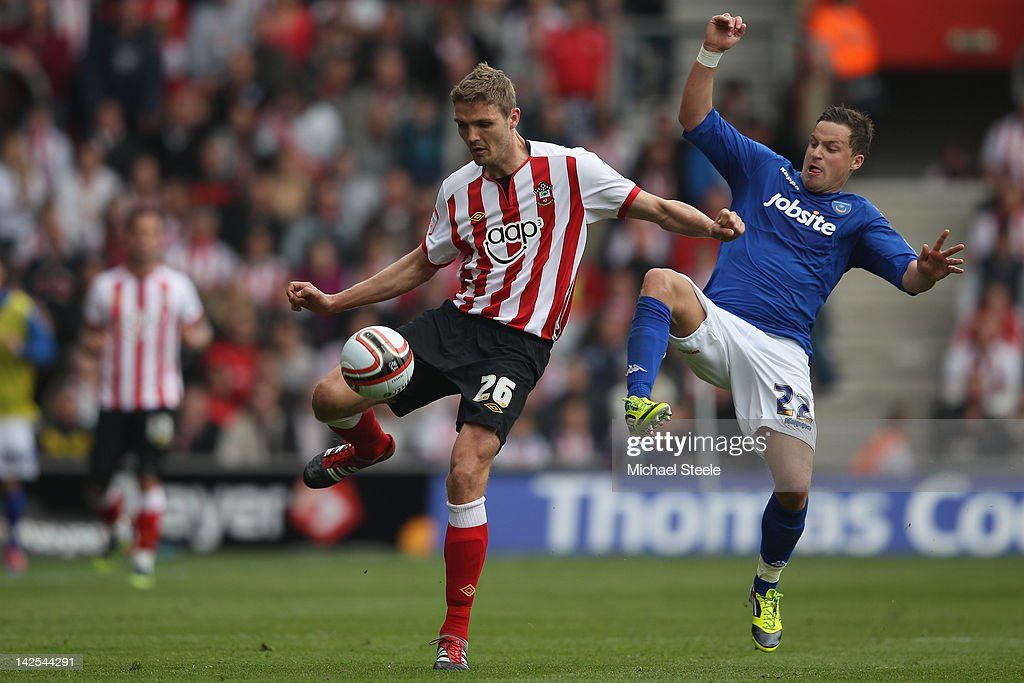 Jos Hooiveld (L) of Southampton challenged by Chris Maguire (R) of Portsmouth during the npower Championship match between Southampton and Portsmouth at St Mary's Stadium on April 7, 2012 in Southampton, England.