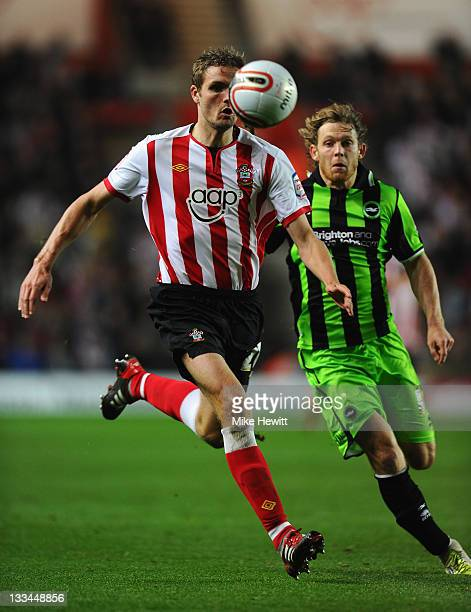 Jos Hooiveld of Southampton is chased by Craig MackailSmith during the npower Championship match between Southampton and Brighton Hove Albion at St...