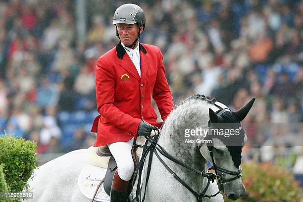 Jos Lansink of Belgium on his horse King Kolibri reacts during the Warsteiner jumping competition at the CHIO on July 13 2011 in Aachen Germany