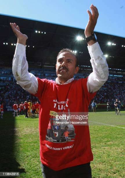 Jos Luhukay head coach of Augsburg celebrates promotion to the Bundesliga after the Second Bundesliga match between FC Augsburg and FSV Frankfurt at...