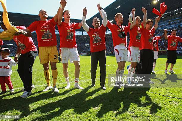 Jos Luhukay head coach of Augsburg celebrates with his players after the Second Bundesliga match between FC Augsburg and FSV Frankfurt at Impuls...