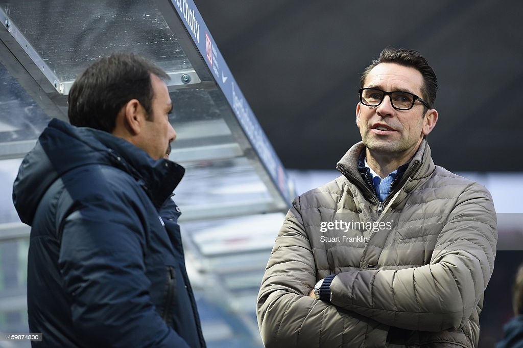Jos Luhukay, head coach of Berlin talks with Michael Preetz, CEO of Hertha Berlin during the Bundesliga match between Hertha BSC and FC Bayern Muenchen at Olympiastadion on November 29, 2014 in Berlin, Germany.