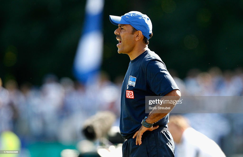 Jos Luhukay, head coach of Hertha BSC reacts during the DFB Cup first round match between VfR Neumuenster and Hertha BSC Berlin at Gruemmi-Arena on August 4, 2013 in Neumuenster, Germany.