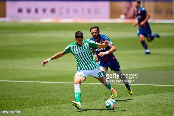 José Luis Morales Nogales of Levante UD competes for the ball with Marc Bartra of Real Betis Balompie during the Liga match between Levante UD and...