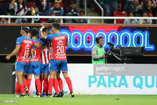 José Macías of Chivas celebrates with his teammates after scoring the second goal of his team during the 1st round match between Chivas and FC Juarez...