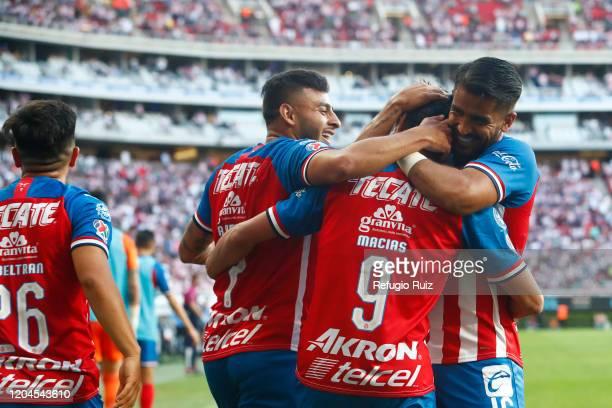 José Macías of Chivas celebrates with his teammates after scoring the first goal of his team during the 8th round match between Chivas and Leon as...