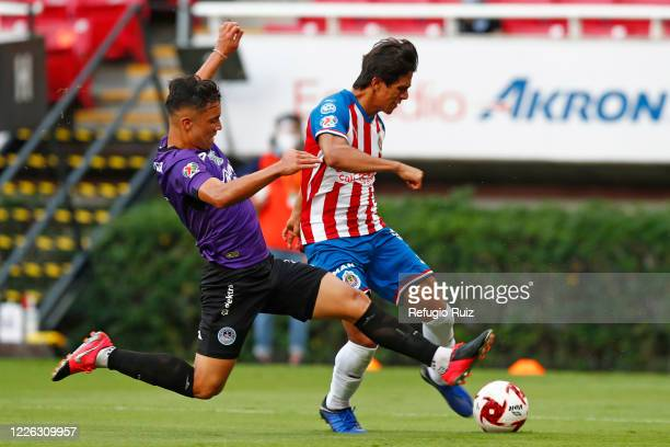 José Macías of Chivas fights for the ball with Nicolas Diaz of Mazatlan during the match between Chivas and Mazataln FC as part of the friendly...