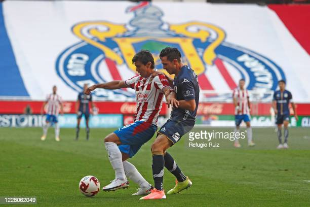 José Macías of Chivas fights for the ball with Ramiro González of San Luis during the 5th round match between Chivas and Atletico San Luis as part of...