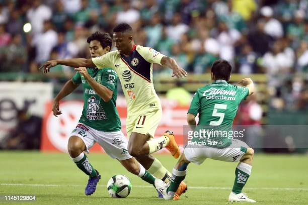José Macías of Leon fights for the ball with Andres Ibarguen of America during the semifinals second leg match between Leon and America as part of...
