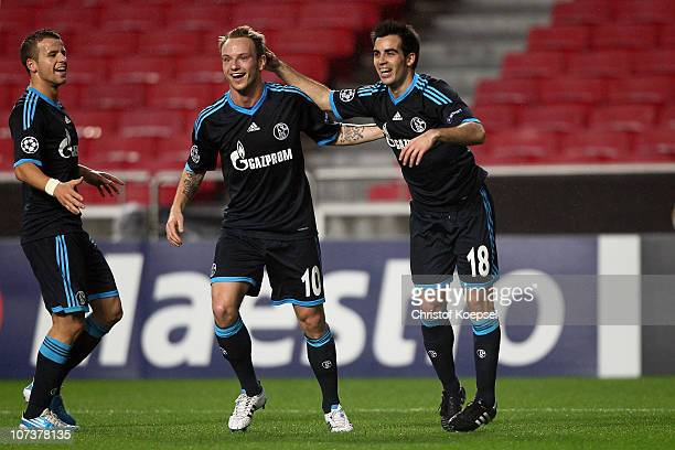 José Manuel Jurado of Schalke celebrates the first goal with Ivan Rakitic of Schalke C and Lukas Schmitz during the UEFA Champions League group B...