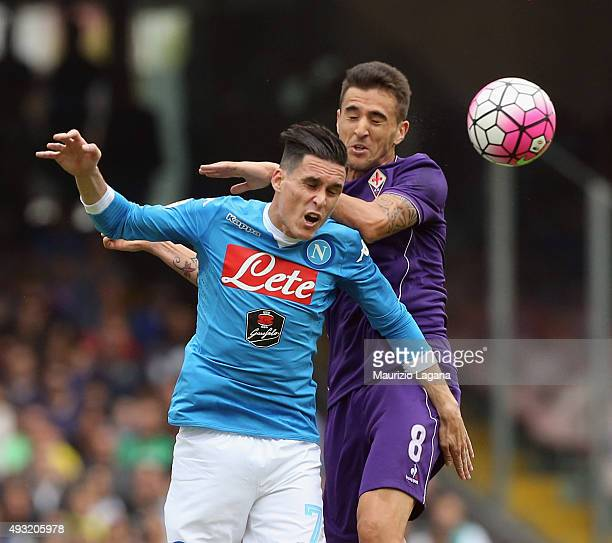 Josè Maria Callejon of Napoli competes for the ball in air with Matias Vecino of Fiorentina during the Serie A match between SSC Napoli and ACF...