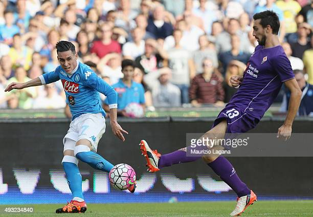 Josè Maria Callejon of Napoli competes for the ball with Davide Astori of Fiorentina during the Serie A match between SSC Napoli and ACF Fiorentina...