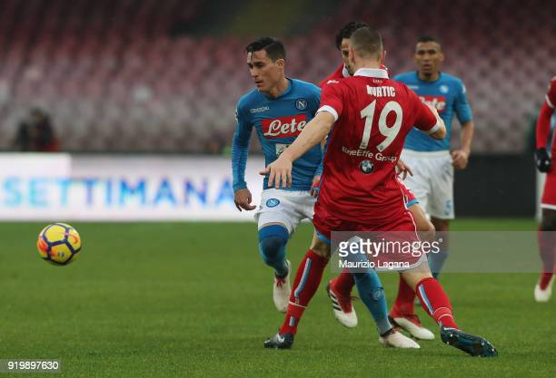 Josè Maria Callejon of Napoli competes for the ball with Jasmin Kurtic of Spal during the serie A match between SSC Napoli and Spal at Stadio San...