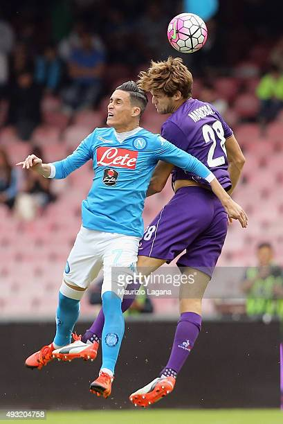 Josè Maria Callejon of Napoli competes for the ball with Marcos Alonso of Fiorentina during the Serie A match between SSC Napoli and ACF Fiorentina...