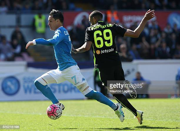 Josè Maria Callejon of Napoli competes for the ball with Samuel Souprayen of Verona during the Serie A match between SSC Napoli and Hellas Verona FC...