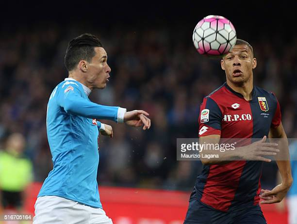 Josè Maria Callejon of Napoli competes for the ball with Sebastian De Maio of Genoa during the Serie A match between SSC Napoli and Genoa CFC at...