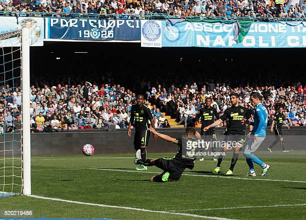 Josè Maria Callejon of Napoli scores his team's third goal during the Serie A match between SSC Napoli and Hellas Verona FC at Stadio San Paolo on...