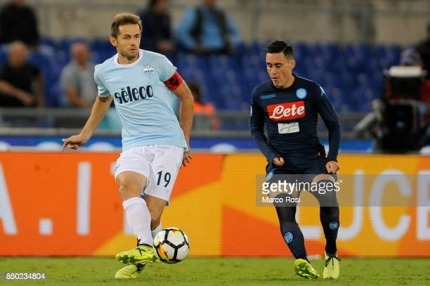 Jos Maria Callejon of SSC Napoli compete for the ball with Senad Lulic of SS Lazio during the Serie A match between SS Lazio and SSC Napoli at...