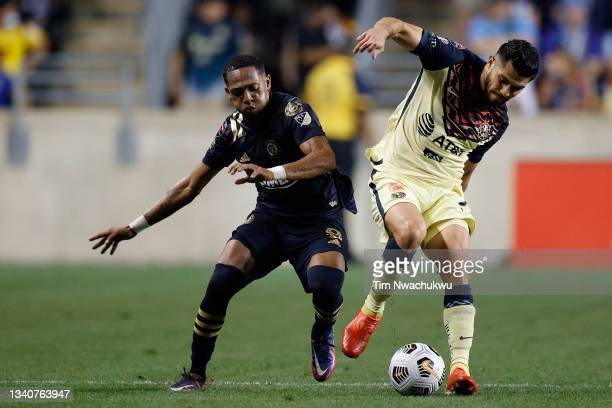 José Martínez of Philadelphia Union and Henry Martín of Club America challenge for possession during the semifinal second leg match of the CONCACAF...