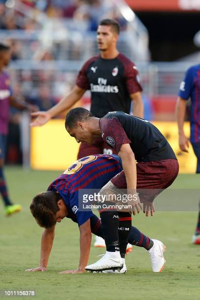 José Mauri of AC Milan talks to Ricky Puig of FC Barcelona after Mauri fouled Puig during the International Champions Cup match at Levi's Stadium on...