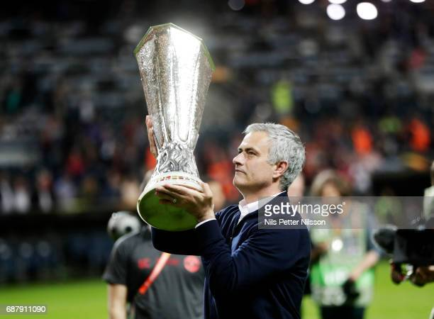 José Mourinho head coach of Manchester United celebrates after the victory with the trophy during the UEFA Europa League Final between Ajax and...