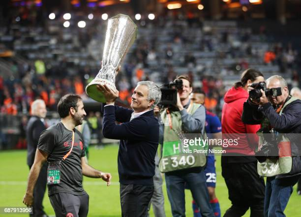 José Mourinho head coach of Manchester United celebrates with the trophy after during the UEFA Europa League Final between Ajax and Manchester United...