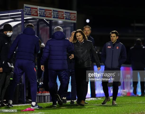 José Mourinho, Manager of Tottenham Hotspur and Gareth Ainsworth, Manager of Wycombe Wanderers embrace at the final whistle during The Emirates FA...