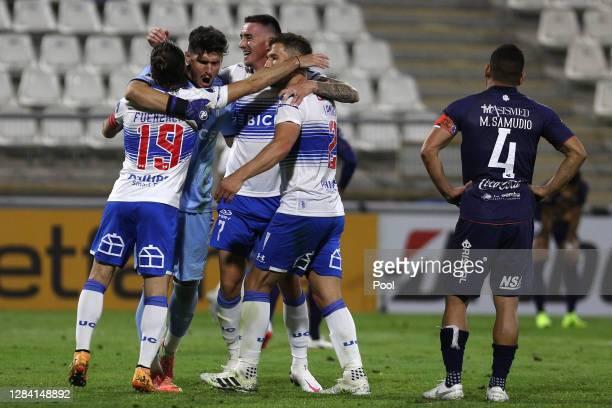 José Pedro Fuenzalida, goalkeeper Matías Dituro, Tomás Astaburuaga and Germán Lanaro of Universidad Catolica celebrate after winning a second leg...