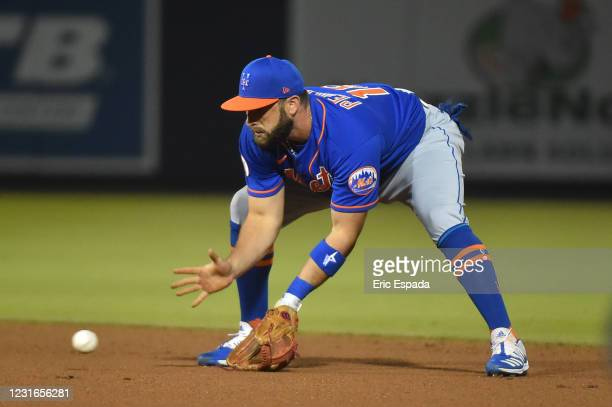 José Peraza of the New York Mets fields a ground ball during the spring training game against the Houston Astros at The Ballpark of The Palm Beaches...