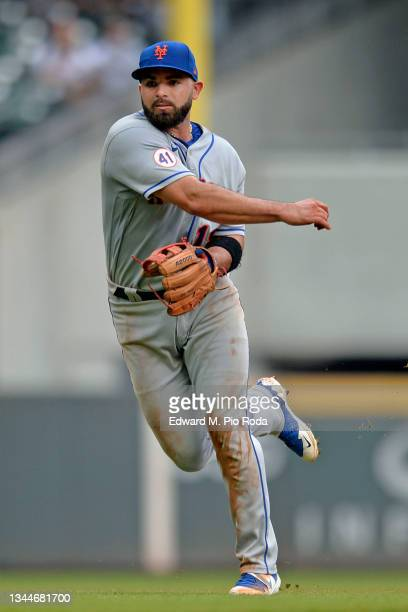 José Peraza of the New York Mets throws to first base during a game against the Atlanta Braves at Truist Park on October 3, 2021 in Atlanta, Georgia.