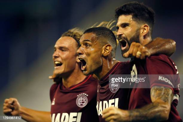 José Sand of Lanus celebrates with teammates after scoring the first goal of his team during a semifinal first leg match between Velez and Lanus as...